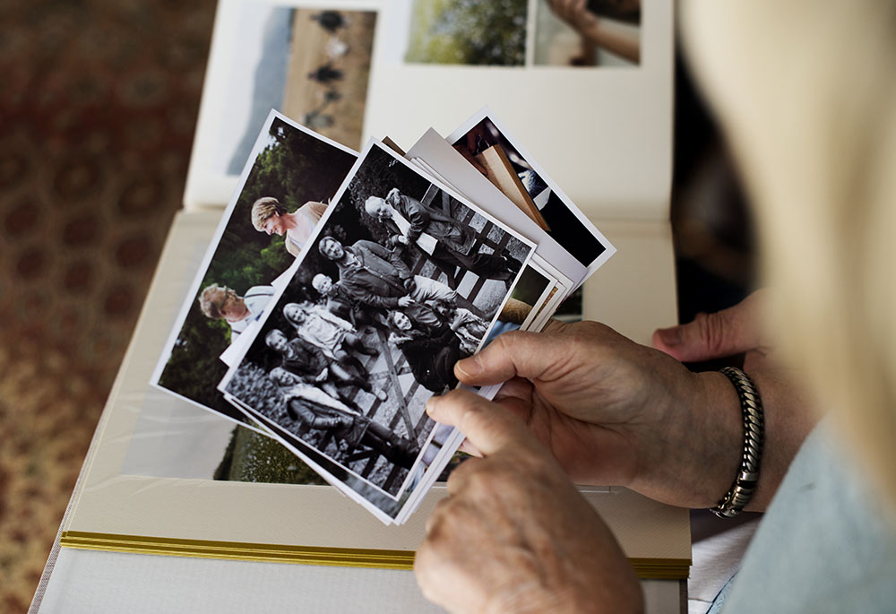 Looking at photographic prints before transfering to digital.